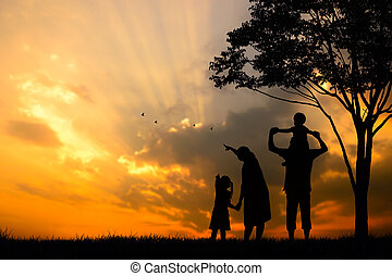 silhouette of a happy family of five people, mother, father,...