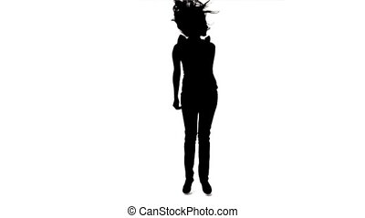 Silhouette of a jumping woman in slow motion