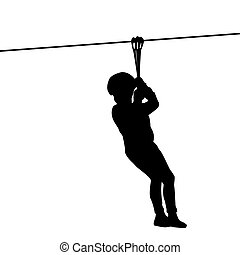 Silhouette of a kid playing with a tyrolean traverse