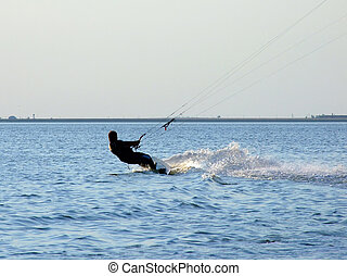 Silhouette of a kite-surf on waves of a gulf 2