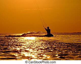Silhouette of a kite-surf on waves of a gulf on a sunset 2