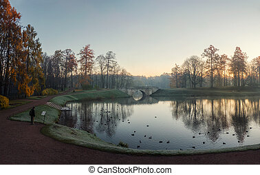 Foggy autumn morning in the Palace Park, Gatchina. Russia.