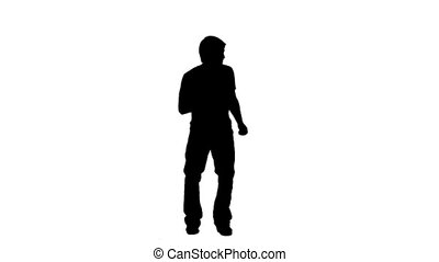Silhouette of a man causally dancing