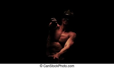 Silhouette of a man dancing in the dark