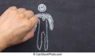Silhouette of a man, drawn in chalk on a blackboard. Top ...