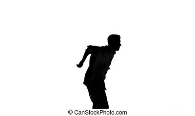 Silhouette of a man jumping and rai