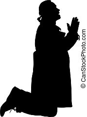Silhouette of a man kneeling in prayer.
