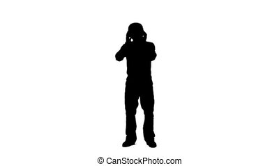 Silhouette of a man listening to music