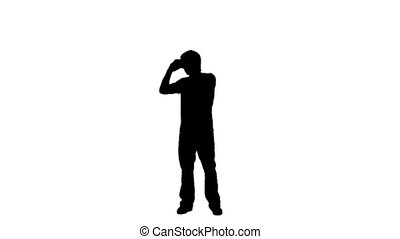 Silhouette of a man looking through binoculars