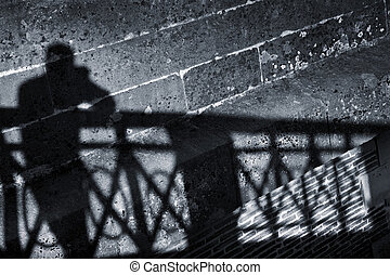Silhouette of a man on a wall