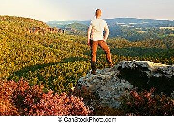 Silhouette of a man on mountain peak.