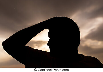 silhouette of a man on the sunset background