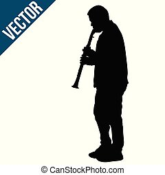 Silhouette of a man playing on clarinet