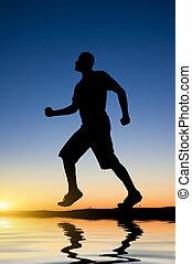 man running against the evening sky