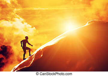Silhouette of a man running up hill