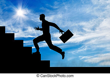 Silhouette of a man running up the stairs
