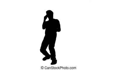 Silhouette of a man singing into a microphone