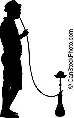 Silhouette of a man smoking a hookah standing beside him