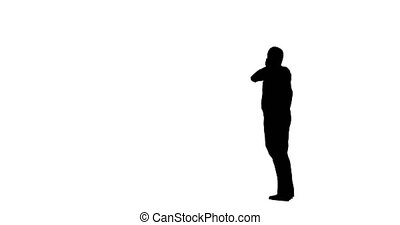 Silhouette of a man stands on a white background