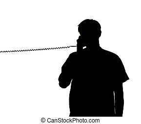 silhouette of a man talking in the phone