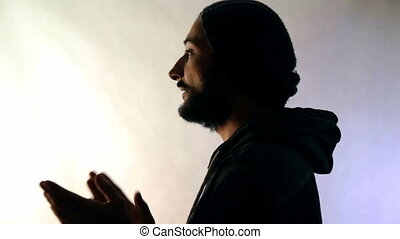 Silhouette of a man that clap on white background