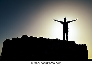 silhouette of a man with open arms