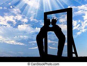 Silhouette of a narcissistic man with a crown on his head hugging his reflection in the mirror