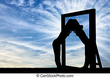 Silhouette of a narcissistic woman hugging her reflection in a mirror