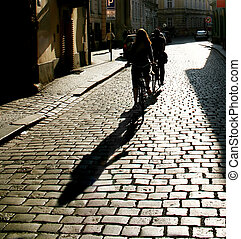 Silhouette of a people riding by bycicle. Prague. Czech Republic