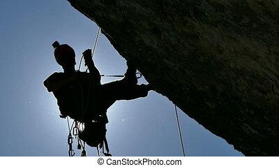 Silhouette of a Rock Climber - Rock Climber Climbing the...