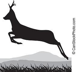 Silhouette of a running deer