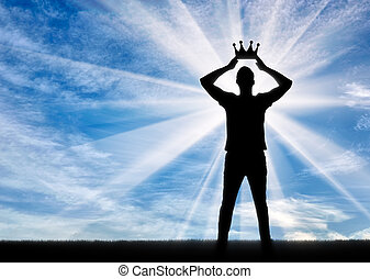 Silhouette of a selfish and narcissistic man reconciling his own crown
