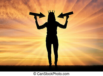 Silhouette of a selfish woman with a crown on her head