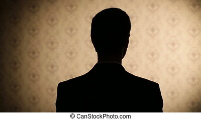 Silhouette of a serious man
