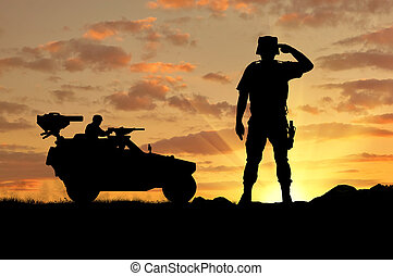 Silhouette of a soldier and military vehicle