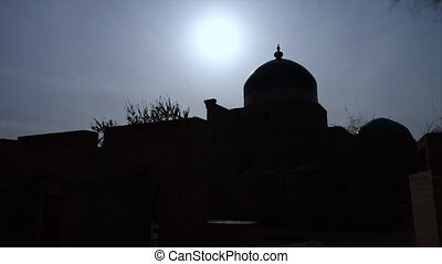 Silhouette of a temple in Uzbekistan - A wide, still shot of...