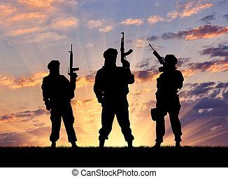 Silhouette of a terrorists - Concept of a terrorist....