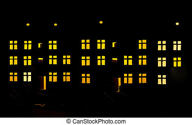 Silhouette of a three-story residential building with ...
