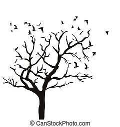 Silhouette of a tree without leaves and birds flying