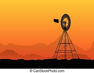 silhouette of a water pumping windmill at the desert