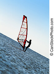 Silhouette of a windsurfer on the sea