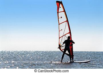Silhouette of a windsurfer
