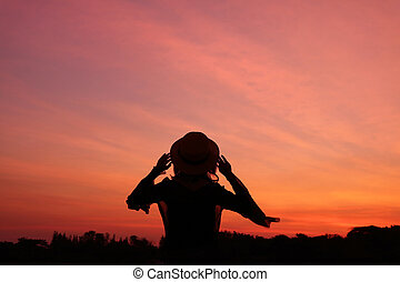 Silhouette of a woman against beautiful sunrise sky