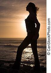 Silhouette of a woman at sunset.