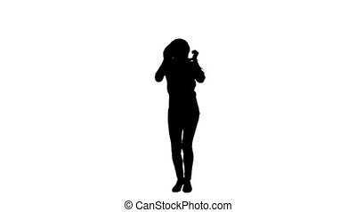 Silhouette of a woman dancing alone