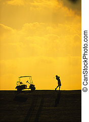 Silhouette of a woman during a golf swing - Silhouette of a...