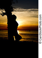 silhouette of a woman in a sunset