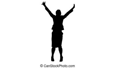 Silhouette of a woman in slow motion jumping