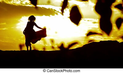 Silhouette of a Woman Poses at Sunset
