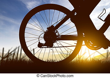 Silhouette of a woman riding a bicycle